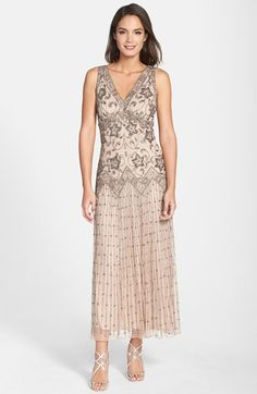 Free shipping and returns on Pisarro Nights Beaded Mesh Dress at Nordstrom.com. Ornate floral beadwork covers the long mesh overlay of a V-neck gown fashioned with a zigzag design at the dropped waistline.  $160