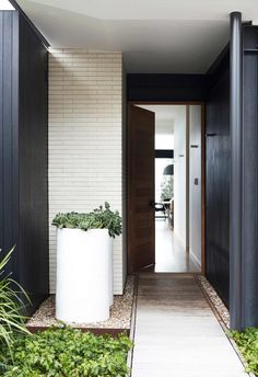 This holiday home on the NSW South Coast may borrow form and function from mid-century design, but its reinterpretation is refreshingly modern.
