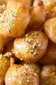 Loukoumades are crispy dough balls covered in aromatic syrup and sprinkled with chopped nuts or cinnamon. They are Greek mini-doughnuts.--This recipe is made with almond milk. Greek Sweets, Greek Desserts, Greek Recipes, Vegan Recipes, Cooking Recipes, Greek Donuts, Mini Doughnuts, Greek Pastries, Breads