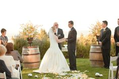 Winery Wedding--barrels used as flower pedestal! Great idea and great look.