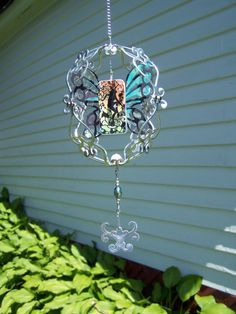 """Wendy Joan Howell  Domino Sculpture, recycled soda can, domino, and fairy graphic from Dover Publication's """"Silhouettes & Stencils Vector Designs""""."""