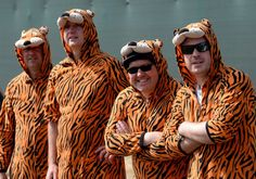 Golf fans in Tiger costumes enjoy the action during the third round of the 142nd Open Championship at Muirfield on July 20, 2013 in Gullane, Scotland. (Photo by David Cannon/R/R via Getty Images)