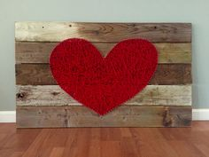2016. Reclaimed wood with heart shaped string art.