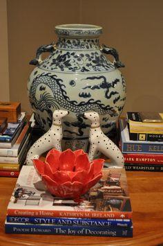 Ginger Jar, dog figurines, books, red ceramic flower