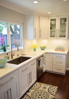 A white kitchen is the perfect backdrop for colorful accessories dishes and accents