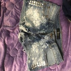 Floral Jean Shorts Floral Jean Shorts size 3. Distressed. In good condition. CP Jeans Shorts Jean Shorts