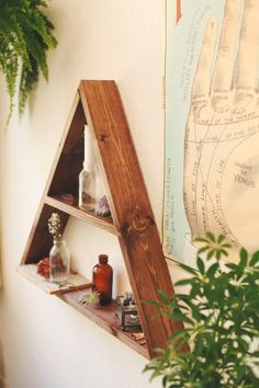 Apothecary triangle shelf, part of my mountain shelf series, is the perfect piece to display your crystals, tarot cards, and vintage trinkets.