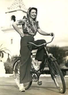 1943, a scarf keep her hair fresh while bike riding to the factory to work