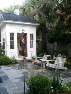 love the slate, tiki torch, light fixture, chairs, and plantings