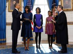 Black & Blue from Malia Obama's Best Fashion Styles  Malia wears an electric blue and black dress and black tights as she joins her family in the Blue Room of the White House to watch her father President Barack Obama take the oath of office in 2013.
