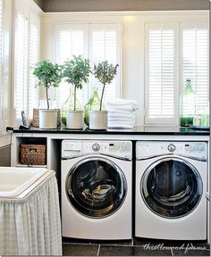 Laundry room design Ideas. Build a countertop for the washer and dryer with built-ins and baskets on the side to add storage and folding space in a laundry room. #laundryRoom Via Thistlewood Farms.