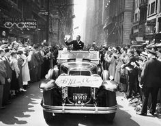 September - JESSE OWENS WELCOME PARADE: Olympic gold medal winner Jesse Owens waves during a ticker tape parade along Broadway in New York City on Sept. The twenty-two-year-old won four gold medals at the Summer Olympics in Berlin, Germany. 1936 Olympics, Berlin Olympics, Summer Olympics, Today In History, Black History Month, Manhattan, Jesse Owens, Marcus Garvey, History Photos