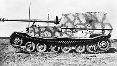 A disabled German Elefant  heavy tank-hunter. It was built in small numbers in 1943 under the name Ferdinand after its designer Ferdinand Porsche, using tank hulls that had been produced for a cancelled German heavy tank design.In 1944, after modification of the existing vehicles, they were renamed Elefant. The official German designation was Panzerjäger Tiger.