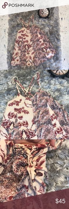 Free People Red and Cream Romper Pre-Loved in Good Condition! The straps criss crosses in the back and are adjustable for your comfort. It has decorative straps on both sides. Please feel free to offer or bundle Free People Dresses