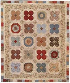 I love the colors and fabrics in this quilt!
