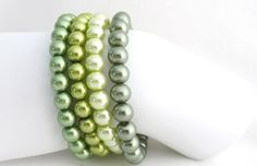 Price  :$11.99 (For 4 Bracelets) Green Bracelet Olive Green Stretchable Bracelet Pistachio Green Bracelet Free Shipping In USA Color Olive ,Green, Lite Green, Pistachio 8mm glass pearls Stretchable bracelet 7 inches up to 7 3/4 inches
