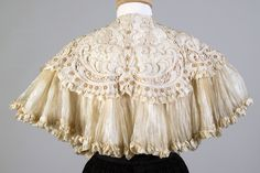 Cape of ivory silk and lace, American, ca. 1900, KSUM 1996.58.398.