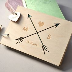 We love this uniquely engraved wooden guest book, with arrow detail and additional personalisation.