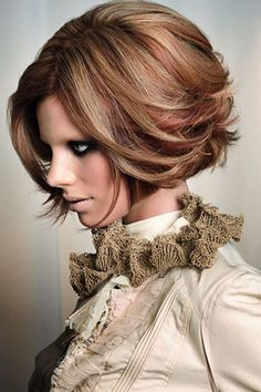 Plan on toning down the color slightly - but I definitely think this will be my new cut & color this weekend!