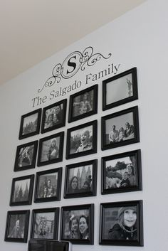 Wall picture arrangement under vinyl lettering
