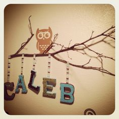 Use a real branch to hang babies name in babies room!
