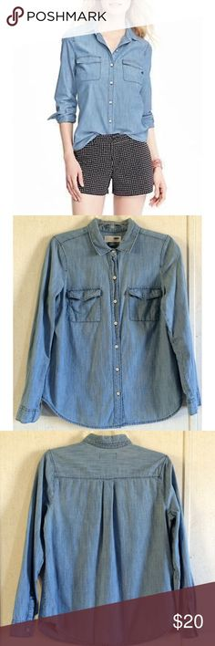 Old Navy Classic Chambray Blouse Great condition. Tiny bit of wear at the end of the cuffs. Really nice Old Navy Classic chambray shirt. Medium blue wash. Buttons all the way up the front with white distressed-look buttons. Two pockets on the front with flaps over. Long sleeves with buttoning cuffs. Size small. All offers welcome Old Navy Tops Blouses