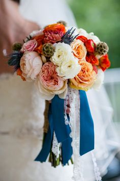 Vibrant #bouquet with nautical flair | Photography: Emilie Inc.  - www.emilieinc.com  Read More: http://www.stylemepretty.com/new-england-weddings/2014/04/10/vibrant-maine-barn-wedding/