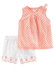 Colorful and cute, this 2-piece set features a sweet poplin top and floral embroidered shorts.