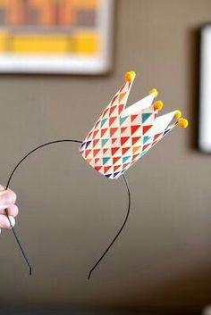 Instead of a headband I would use elastic to wear like a bday party hat