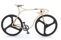 Wooden road bicycle for Thonet using the steam-bending processes the German furniture company first used in 1859 for the company's classic cafe chair.