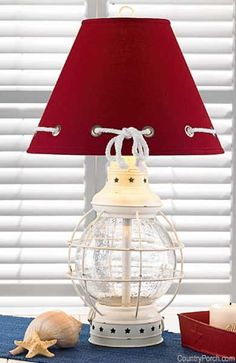 Nautical lamp with red shade...