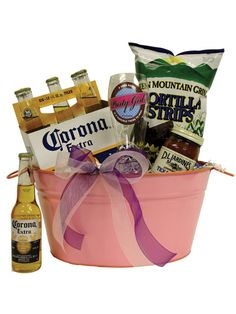 Corona Beer Gift Basket  Item Number:2010052594 Girl's Night Out! A beer basket that offers six bottles of Corona, a Mexican beer favorite along with fresh limes, spicy snacks that include tortilla chips, zesty salsa and a handpainted Party Girl Pilsner beer glass from Lolita all packaged in a party pail to keep your Corona cold!