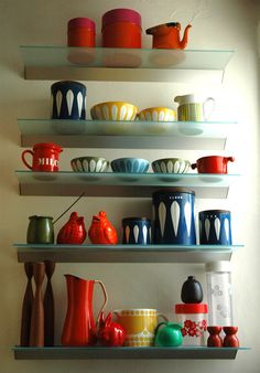 jolis pots {love the catherine-holm style? ceramics and the display. fab!}