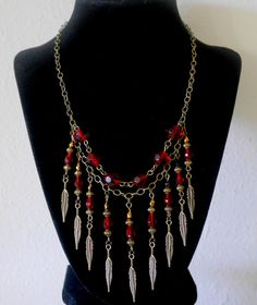 Red crystal necklace with dangling charms