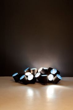 Lamps made of recycled tin cans ... perhaps for occasional lighting? (Via MocoLoco.com)