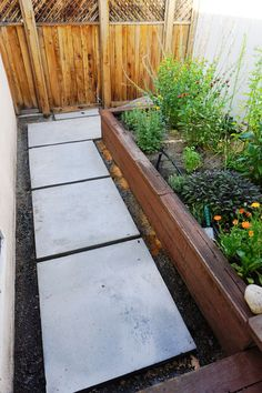 DIY Concrete Pavers can be built to fit your space and look fantastic. Click through for a step-by-step tutorial to build your own bad-ass walkway.
