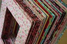 Cereal boxes covered in fabric for picture frame mattes