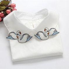Swan embroidered shirt collar.