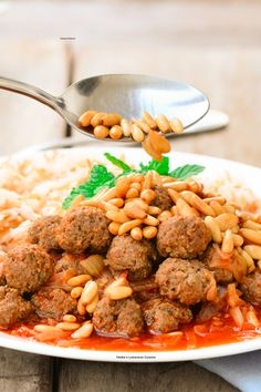 Dawood Basha (Lebanese Meatballs in Tomato Sauce)! They are tender and moist and can be made of pure ground beef or simply a combination of both beef and lamb. Lamb adds a pleasant dimension!! A perfect family meal and a pure comfort food for the body and soul! Serve it with Lebanese rice and vermicelli or simply with plain rice. Chinese Meatballs, Italian Meatballs, Lebanese Recipes, Meatball Recipes, Tomato Sauce, Ground Beef, Family Meals, Cooking Recipes, Ethnic Recipes