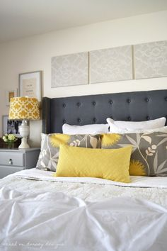 Interior. Awesome Upholstered Tufted Headboards Design Ideas. Cool Modern Bedroom With Fabric Upholstered Tufted Headboard For Bed Design Ideas Featuring White Wall And White Varnished Wooden Cabinet Plus White Fabric Bed Cover Together With Gray Fabric Modern Tufted Headboard And Also White Pillow Plus Yellow Pillow And Also Assorted Color Flower Pattern Pillow And Also White Varnished Wooden Table Lamp With White Yellow Modern Pattern Shade