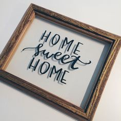 Home sweet home   Sign for the entry of your home to welcome in your lovely guests. This floating frame was created by Front Rowe Designs & Lyssarts. The lettering was done between two sheets of glass so that the glass can be cleaned without any fear of removing the lettering. Perfect gift for newlyweds or for your parents!   Handlettered by Lyssarts