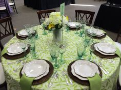 Illiana linen, brown wicker chargers, Masionette china, & green Mexican glassware. Perfect for a garden party or tea!