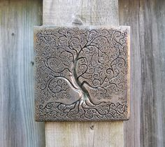 """I created this Tree of Life by hand carving into plaster, and then molding and casting and finishing it in my home studio. It is just over 6"""" square."""