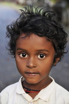 "India's Future--Indians from India have the most incredible look about them, in almost everyway. Their skin is is a gift  from The Creator, the expression this child's face is one of curiousity but also, to me, there is look of ""opinion, and maybe even a little bit of 'jugement' too !"