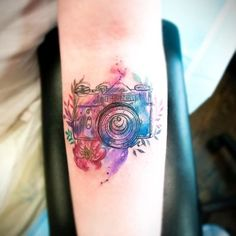 Colorful camera tattoo on the forearm - Styleoholic