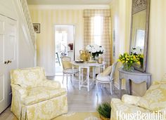 Pale yellow and white - subtle stripes, check fabric on curtains, floral fabric on chairs - Mary Douglas Drysdale; photo by Bjorn Wallander for House Beautiful