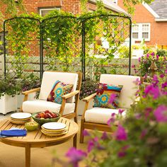 Breezy Living Room        Make your patio a cozy spot to relax by mimicking an indoor living room. Arrange furniture around a table for a place to set drinks and food. Use accent pillows to add a touch of color. A metal screen creates a faux wall that separates the patio from yard next door.