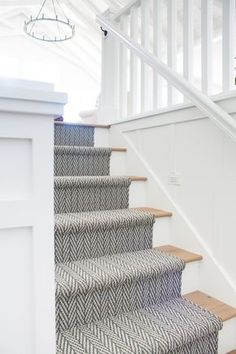Vintage Home Herringbone stair runner - Oar rack wall decor. Board and batten walls, white oak flooring and chippy vintage oars on oar racks. Oak Stairs, Basement Stairs, House Stairs, Cottage Stairs, Open Basement, Basement Ideas, Garden Stairs, Basement Carpet, Colors