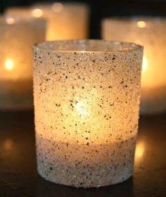 Beach sand craft idea. Glue sand to a votive candle holder for a warm beachy glow.