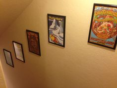 I turned the Disneyland Attraction Art Poster Calendar into decorations down the basement stairs. Cheap frames at Michaels and cut the pages to fit - super cheap way to decorate the stair walls and so totally Disney (and me)!